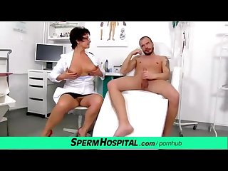 Older uniform lady Greta teasing a patient with her big natural tits