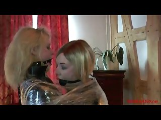 Wrapped gagged and suffocating together by mistress O