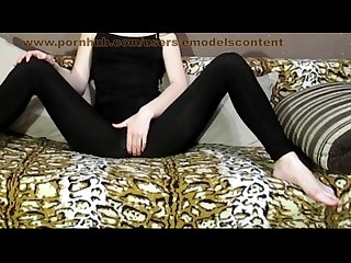 Slutty teen in black leggings showing off her body in tight clothes in bed