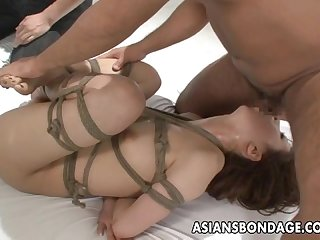 Asian beauty tied up and fucked with a good orgasm