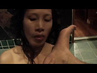 Thai milf licks feet rims and gives bj