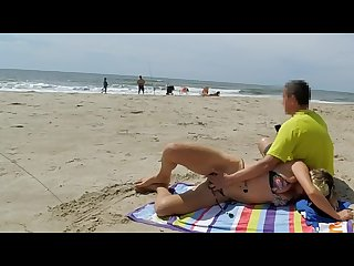 Real amateur public handjob risky on the beach people walking near