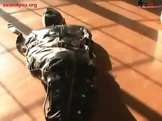 Asian tied in a sleepsack vibed and strapped