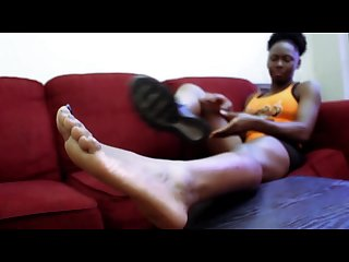 Sexy ebony soles of soleful nikki removing running shoes showing bare feet