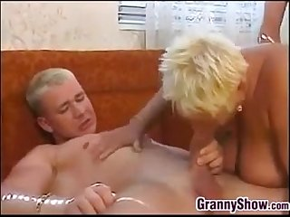 Chubby granny with two guys in a threeway