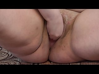 A fat girl in black panties masturbates her pussy with a vibrator