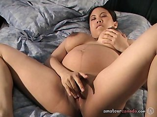 Petite amateur pregnant asian girl plays in homemade porn