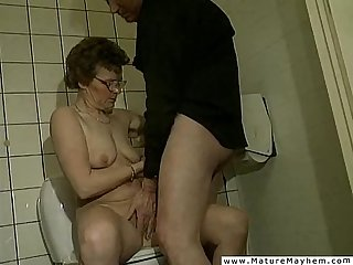 A really old dirty granny performing a jawbreaking blowjob