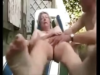 Granny having fun in court yard period Amateur older