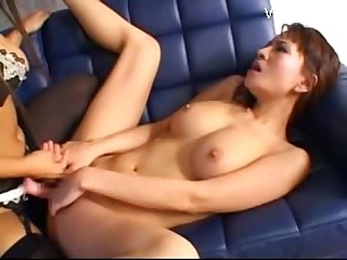 Asian girl gets her pussy fucked with strapon