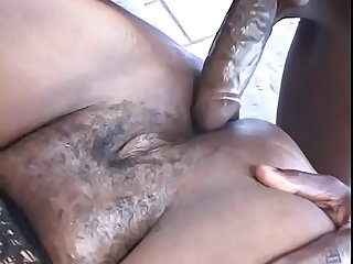 Fat black woman is on her knees sucking on black cock