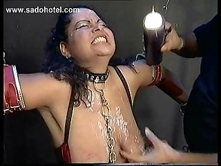 Two slave tied in a dungeon got their face and body covered with hot candlewax and hit with a whip