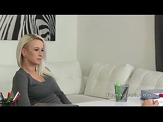 Busty gets strap on from behind in casting