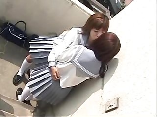 2 japanese schoolgirls kissing on rooftop