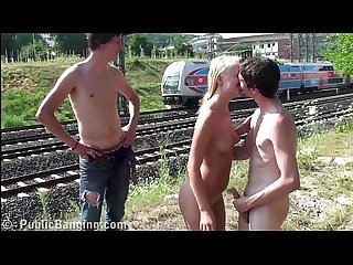 A guy is jerking on his best friend girlfriend in public by a railway