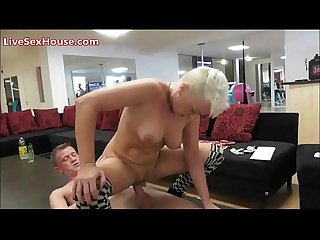 Blonde milf getting down on a coffee table