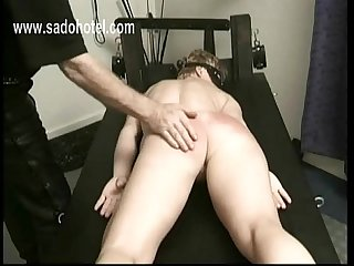 Masked slave is finger fucked by her master and gets spanked on her butt with a whip