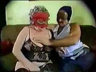 Old masked granny having fun