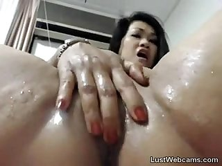 Asian MILF toys her pussy and ass on cam