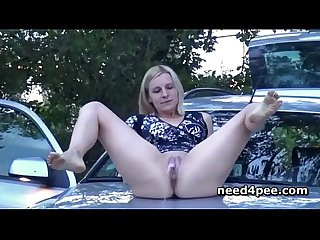 Wide opened blonde pissing in her car top