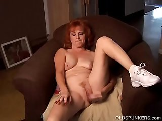 Gorgeous Ginger old spunker playing with her soaking wet cunt 4 u