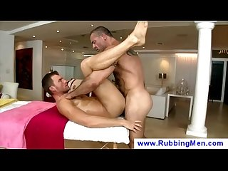 Rough masseur lubes his clients asshole