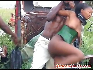 Enchained African babe gets Abused by two horny black guys