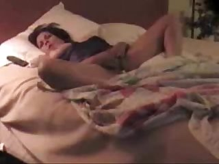 My mature mom masturbating on bed hidden cam