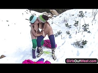 Hairy and shaved lesbian fingering on snow