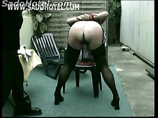 Master unties horny older slave from chair and hit her on her ass and pussy with a whip