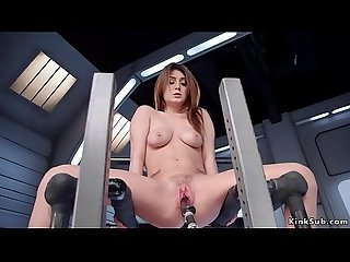 Busty brunette fucks black dildo machine