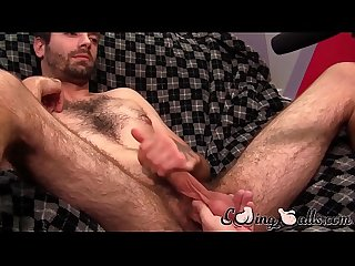 Handsome stud gets his balls caressed while cumming